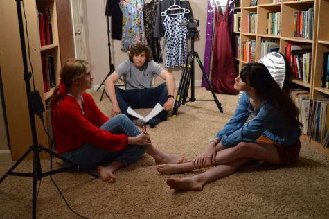 SETTING THE STAGE: Lead actress Marin Koch (11) (left) gets ready to film a scene with the help from director Nolen Stevens (12).