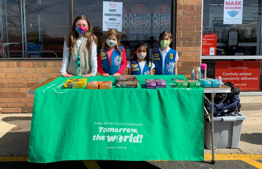 A TASTY TRADITION: Girl Scouts from Troop 55779 sell cookies at Jewel Osco in Woodridge.