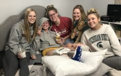 RECOVERING: Junior Ella Sebek rests after ACL surgery with ice cream and friends.