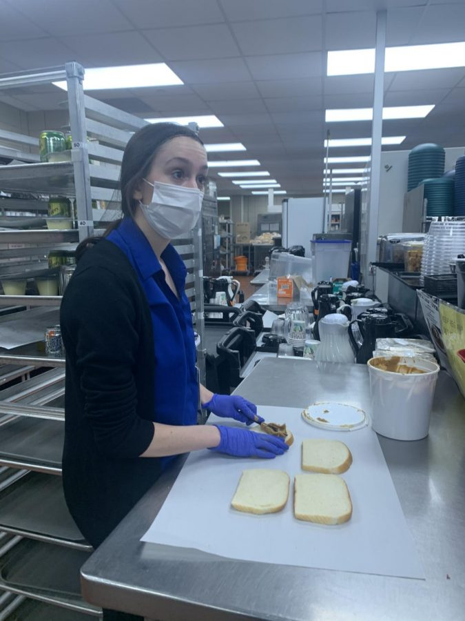 MAKING MEALS: Senior Jane Theisen prepares meals for patients while working as a food service aid.