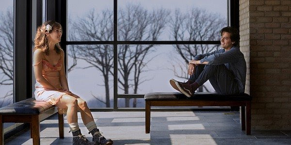 LOVE VS. LIFE: Stella (Haley Lu Richardson) and Will (Cole Sprouse) sit five feet apart as they have to make the decision between being together and or risking their chance at life. Both deal with Cystic Fibrosis, a life-threatening disease, and know the potential consequences to their actions.