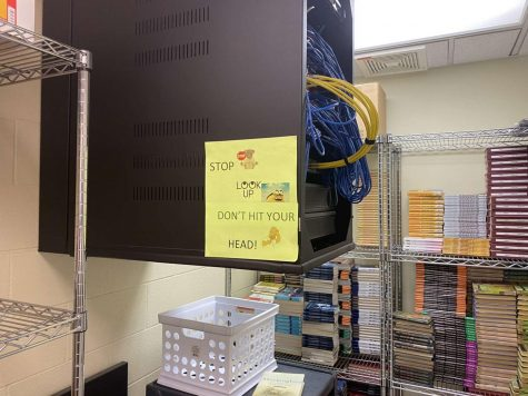 STOP AND LOOK UP: the IDF cabinet in the English office closet, which now has rubber lining and a sign on it.