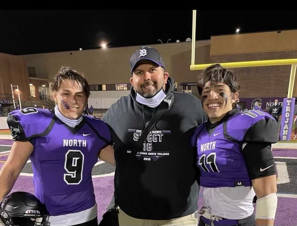 COMRADERY: Coach Lenos, seniors Eric Petrousek (left) and Danny Bancoro (right) smile after a game.