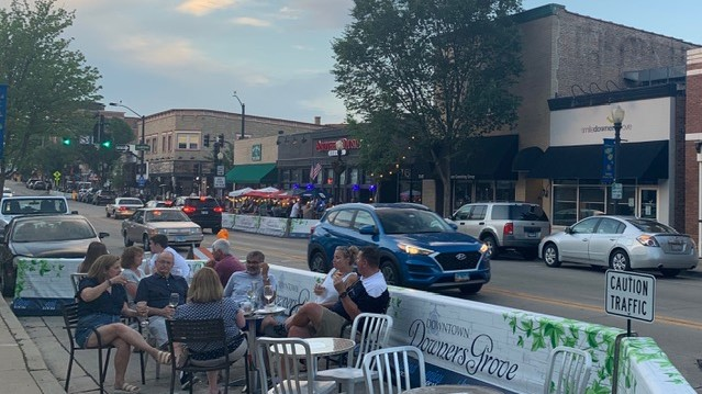 A HOPEFUL HORIZON: From packed restaurants to crowded streets, Downers Grove is beginning to show signs of normalcy this summer after a year of desolate roads and silent shops.