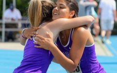 CELEBRATING: Incoming senior Abby Streff hugs graduated senior Kenna Cinotte after the 4x100 meter relay at state.