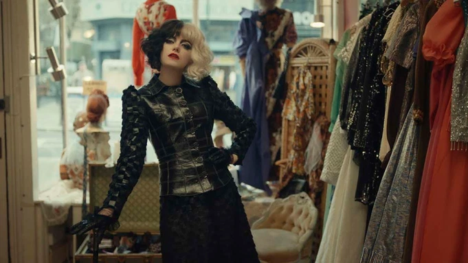 SLY STYLE: Cruella (Emma stone) assumes a mischievous glance at the camera as she formulates her vengeful plan to overthrow her rival, the Baroness (Emma Thompson).