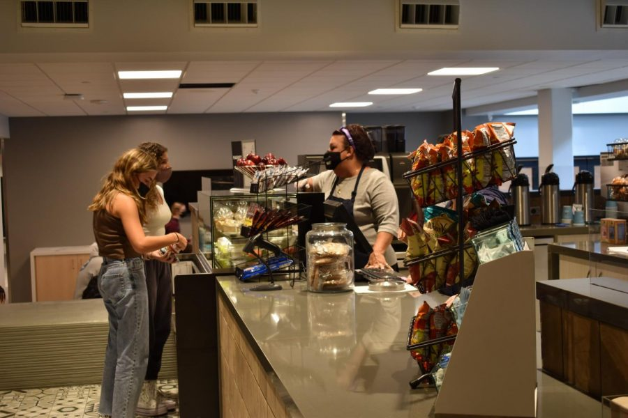 COFFEE RUN: Feldmeier rings up students during their fifth period lunch.