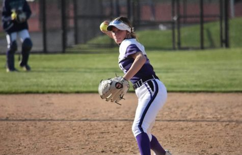 DEFENSE: Janicki throws baserunner out during a softball game last spring.
