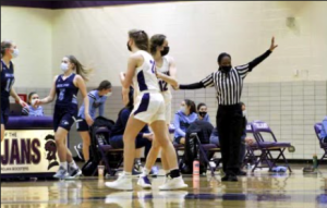 SUPPORT : Ryan Wendt (left) and Violet Mitchell (right) encourage each other during a game.