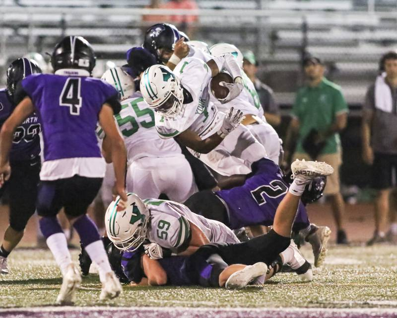 TRIPPED UP: York running back Kelly Watson fights for yards against DGN defenders