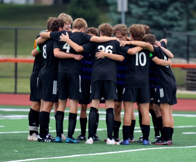 """TEAM HUDDLE: """"The LT game gives us hope because it shows that we can keep up  with some of the top teams in the state,"""" Lesley (12) said."""