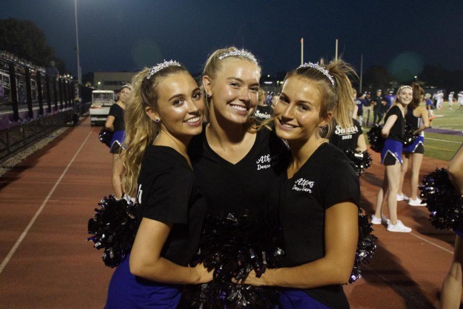 FINALLY SENIORS: four year varsity athenas Emma Gramm, Abby Washburn and Ava Gallwas celebrate their senior night during the first football game