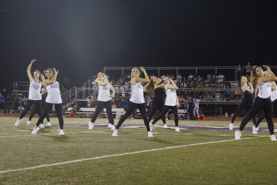 DANCE BREAK: varsity Athenas perform their first routine during half time to keep the students riled up