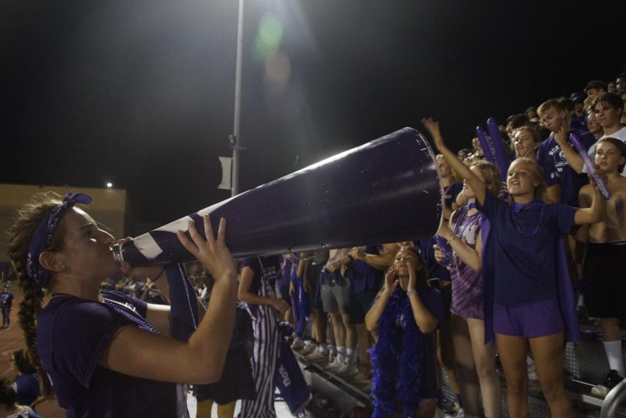 NEVER TOO LOUD TO CHEER: N-Zone leader Maggie Ward leads the crowd in cheering on the football team