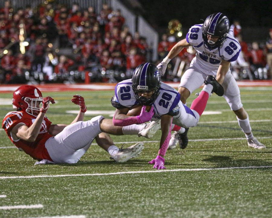 EVERY YARD COUNTS: DGN sophomore running back Noah Battle dives while carrying the ball.