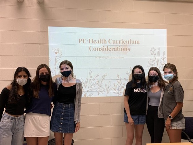 FACING THE PROBLEM: Akshi Mistry (12), Madeline From (12), Heather Ramsey (12), Maddy Mcgovern (12), Helen Larkin (12), and Veronica Lasota (11) present to Health Department on new considerations