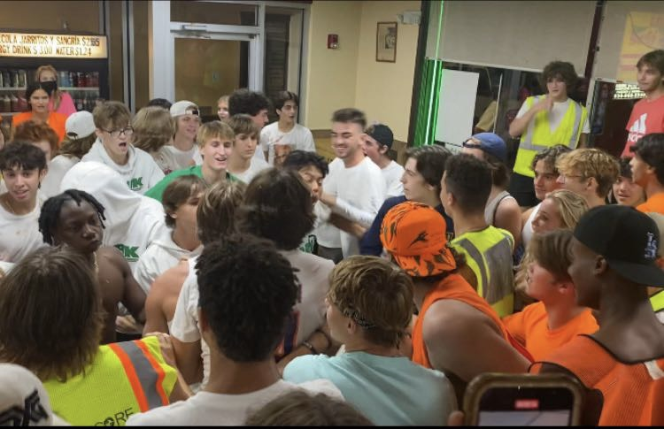 DEFENDING LOS: DGN students in construction outfits square off with the white-shirted York students. The confrontation led to a food fight and police involvement.