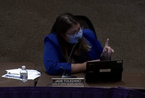 SPEAKING UP FOR STUDENTS: Jade Toledano (12) briefs school board on current and upcoming student activities at DGN.