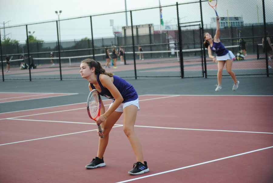 ON THEIR TOES: Meghan (front) and Kate (back) Southworth compete in a doubles match against St. Charles East.